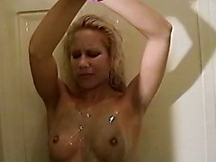 Smoking hot chick bound in the shower and covered with soap